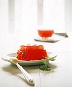 Grapefruit jelly on dessert plate
