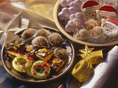 Two colourful plates of assorted Christmas biscuits