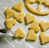 Decorating the edge of marzipan hearts with a fork