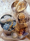 Delicate Christmas biscuits in silver boxes