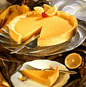 Lemon tart, a piece cut and one piece on plate