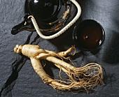 Ginseng root, bowl of ginseng tea and teapot