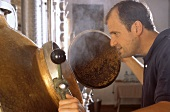 Distiller Karl Holzapfel looks into still