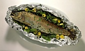 Salmon trout in aluminium foil with leeks