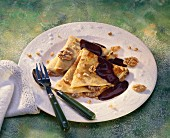 Filled pancakes with chocolate sauce and walnuts