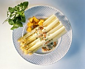 White asparagus with egg and caviare sauce & fried potatoes