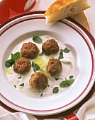 Minced lamb balls with minted yoghurt sauce