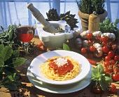 Tomato and herb still life and spaghetti with tomato sauce