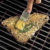 Brushing Tuna Steak on the Grill