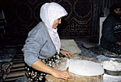 Woman Rolling Out Bread Dough