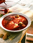 Cold strawberry soup with redcurrants and amaretti