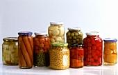 Various preserving jars with vegetables, fruit, sausages