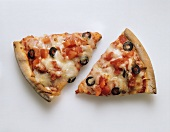 Two pieces of pizza with tomato, cheese and olives