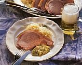 Smoked pork rib with sauerkraut & pea puree, décor: beer glass