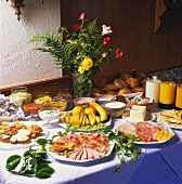 Breakfast buffet with sausage platters, fruit, rolls etc