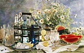 Still life with water, ice cubes & watermelons on table