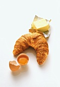 Croissant, butter and an egg