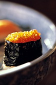 A Sushi Roll Filled with Caviar