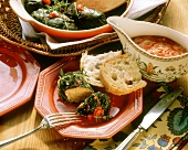 Stuffed chard rolls with tomato sauce on plate