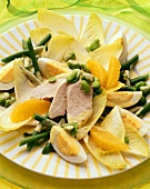 Chicory-bean salad with orange segments & sliced turkey breast