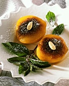 Caramelised apricots, decorated with almonds & a sprig of mint