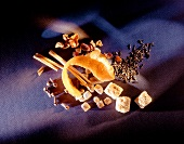 Punch ingredients (tea, sugar crystals, orange peel, spices)