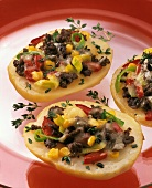 Baked potato halves with mince and vegetable stuffing