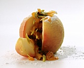 Baked apple with dried fruit & pistachio stuffing, cut open