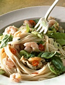 Spaghetti with seafood, chili rings, basil
