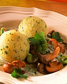 Mushrooms with herb cream sauce & potato dumplings