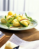 Marinated potatoes with apple wedges, Parmesan & rocket