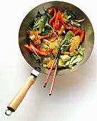 Wok with cabbage, pineapple, pepper ,sprouts, sesame