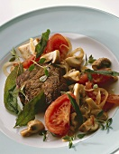 Marinated beef steak with mushrooms, tomatoes & herbs