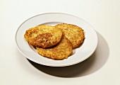 Three potato pancakes on plate