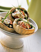 Small spinach and cheese quiches with tomatoes