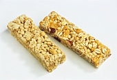Two muesli bars with fruit and nuts