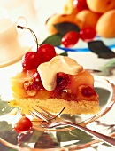 A piece of fruit gateau with apricots & cherries
