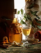 Home-made apple liqueur in glass and carafe