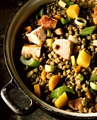 Lentil stew with pork neck, carrots and celery in pot