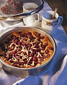 Cherry tart with slivered almonds in baking tin