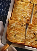 Tray-baked quark cake with almonds and raisins