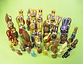 Lots of different chocolate Easter Bunnies on green background