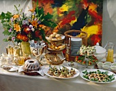 Brunch buffet with snacks, marble cake, bread etc