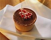 Frozen coffee dessert in mould, decoration: redcurrants