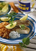 Coley fillets with herb sour cream & tomato rice
