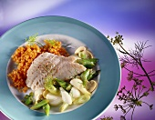 Red perch fillet with leeks and red lentils on plate