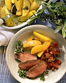 Lamb fillet with tomatoes and saffron potatoes