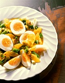 Boiled eggs with orange and spring onion ragout
