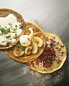 Pancakes with cranberries, ice cream, whipped pistachio sauce