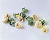 Home-made green and white tortellini